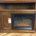 Entertainment center featuring an electric fireplace